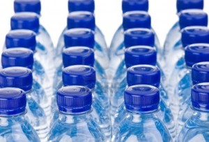 9439782-rows-of-water-bottles-isolated-on-white-background